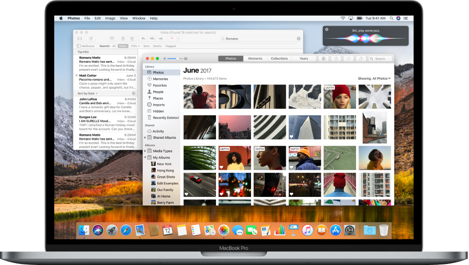 Mac コンピュータ。デスクトップ上でアプリケーションが開いています。