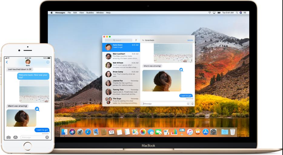 Um iPhone próximo a um Mac, com o Mensagens aberto em ambos os dispositivos, exibindo a mesma conversa por mensagens.