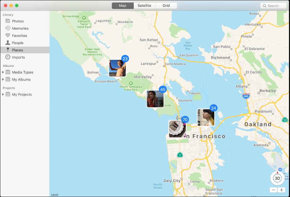 Ventana de Fotos que muestra un mapa con miniaturas de fotos agrupadas por ubicación.