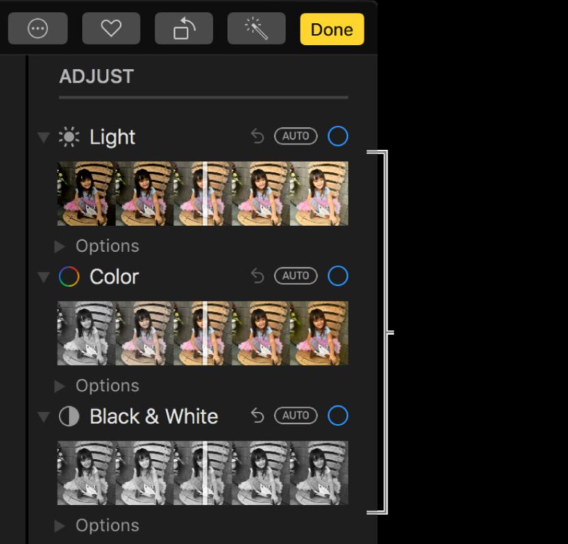Lys-, Farge- og Svart-hvitt-skyveknappene i Juster-panelet. En Auto-knapp vises over hver skyveknapp.