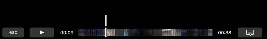 """Los controles de reproducción en la Touch Bar. El botón """"Reproducir/Pausar"""" se sitúa a la izquierda junto al cursor de reproducción, que puede arrastrar para ir a un punto específico del archivo. A la izquierda del cursor de reproducción se sitúa el tiempo transcurrido y a la derecha el tiempo restante."""