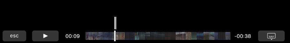 De afspeelregelaars in de TouchBar. Links staat de knop voor afspelen/pauzeren; daarnaast staat de afspeelkop, die je kunt slepen om naar een specifiek punt in het bestand te gaan. Links van de afspeelkop staat de verstreken tijd en rechts staat de resterende tijd.