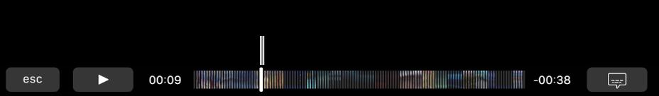 Os controles de reprodução na Touch Bar. O botão Reproduzir/Pausar está à esquerda e do lado dele encontra-se o cursor de reprodução, que você pode arrastar até um ponto específico no arquivo. À esquerda do cursor de reprodução encontra-se o tempo decorrido e, à direita, o tempo restante.