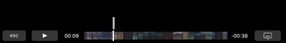 Touch Bar 中的播放控制項目。 左側為「播放/暫停」按鈕,其旁邊則為播放磁頭,可供您拖移來移至在檔案中的特定點。 播放磁頭的左側為經過時間,右側則為剩餘時間。