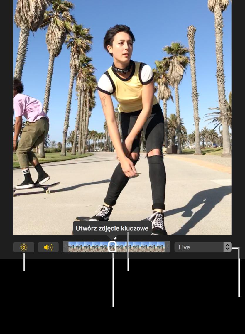 Zdjęcie Live Photo wwidoku edycji zwidocznym poniżej suwakiem zawierającym klatki zdjęcia. Przyciski Live Photo oraz Głośnik znajdują się po lewej stronie suwaka, natomiast po prawej stronie jest menu, którego możesz użyć do wybrania efektu pętli, odbicia lub długiej ekspozycji.