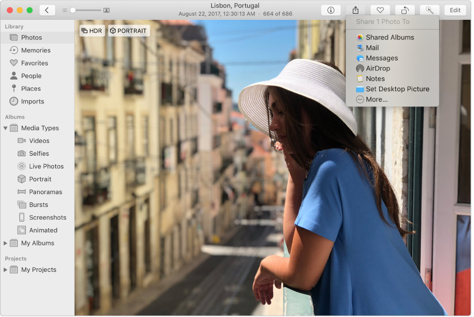 The Photos window showing a photo and the Share menu with the Shared Albums command selected.