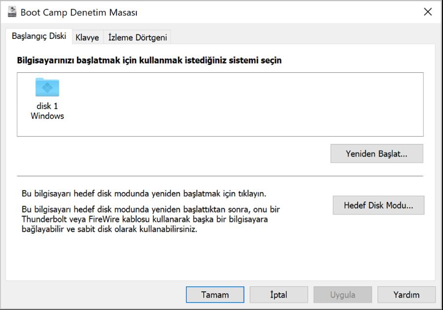 Boot Camp Denetim Masası, bilgisayarınızı yeniden başlatma veya bilgisayarı hedef disk modunda kullanma seçeneklerini de içeren başlangıç diski seçme penceresini gösteriyor.