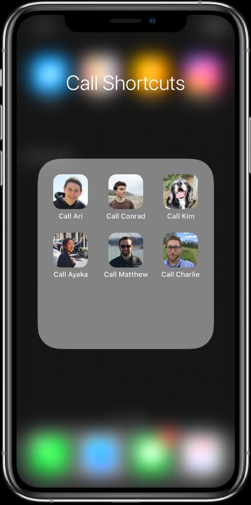 Ring-snarveier i en mappe på Hjem-skjermen som viser bilder av kontakter.