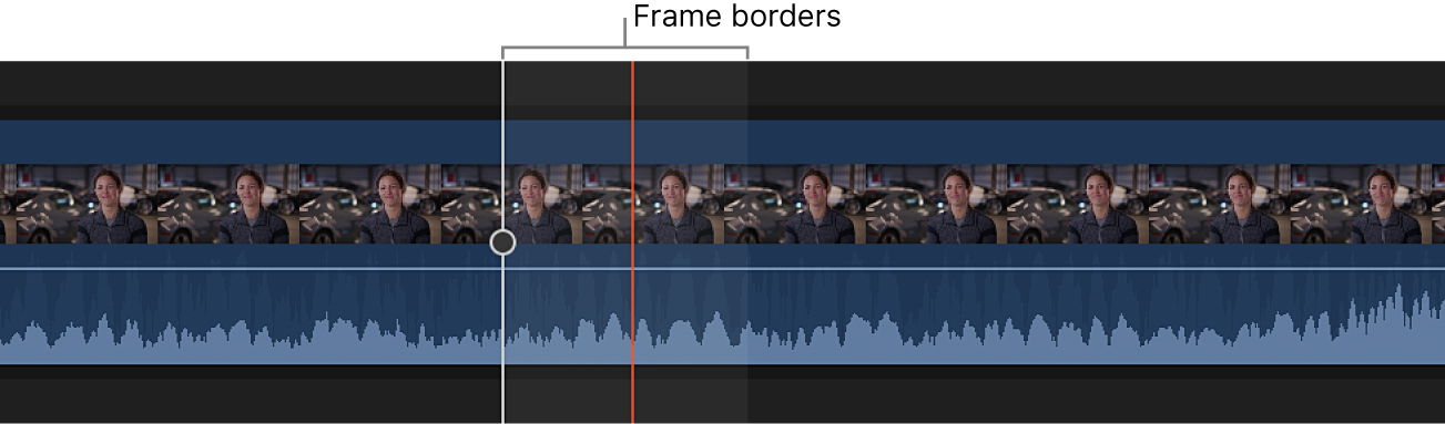 A clip in the timeline zoomed in to show the audio waveform within the borders of a video frame