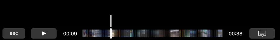 Los controles de reproducción en la TouchBar. El botón Reproducir/Pausa está a la izquierda y al lado está el cursor de reproducción, que puedes arrastrar para ir a un punto específico del archivo. A la izquierda del cursor de reproducción está el tiempo transcurrido y a la derecha está el tiempo restante.