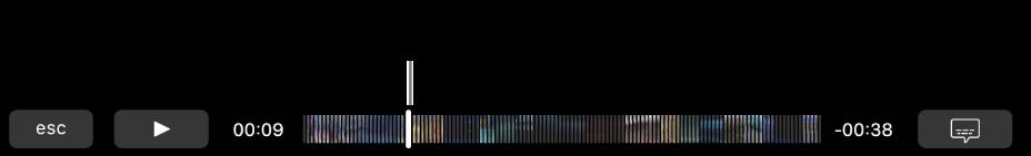 Touch Bar에 있는 재생 제어기. 재생/일시정지 버튼이 왼쪽에 표시되어 있고 바로 옆에는 드래그하여 파일의 특정 위치로 이동할 수 있는 재생헤드가 표시되어 있음. 재생헤드 왼쪽에는 경과된 시간이 표시되어 있고 오른쪽에는 남아 있는 시간이 표시되어 있음.