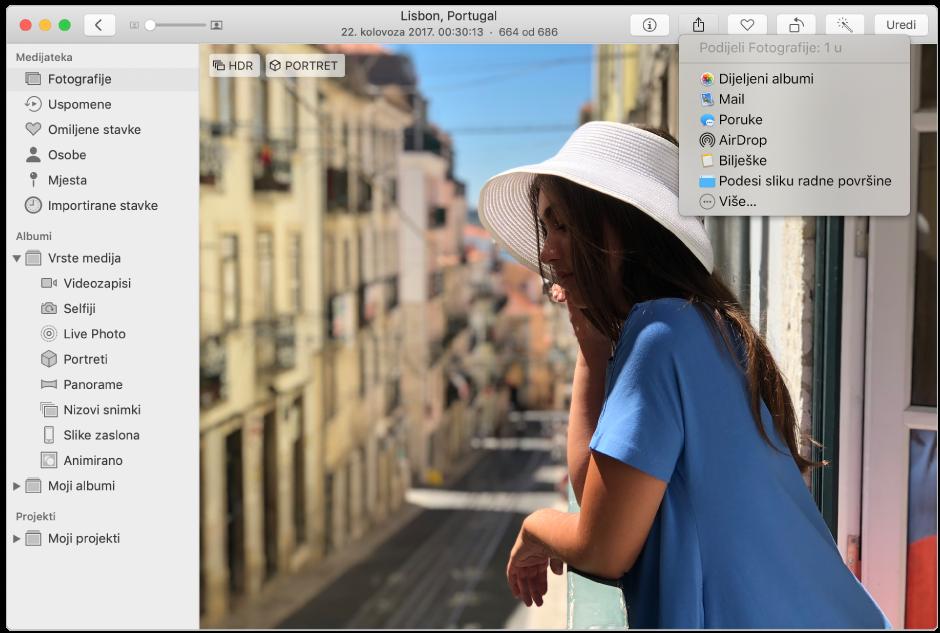 Prozor aplikacije Foto prikazuje fotografiju i izbornik Dijeli s odabranom naredbom Dijeljeni albumi.