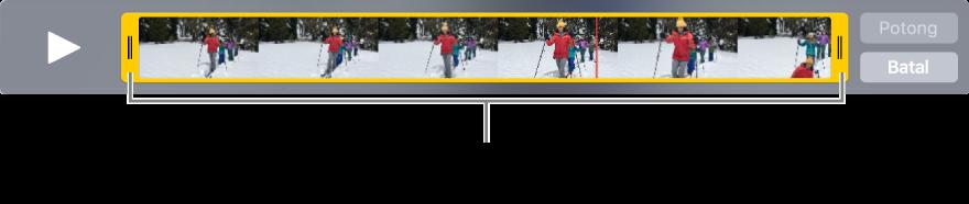 Pemegang pangkas kuning dalam klip video.
