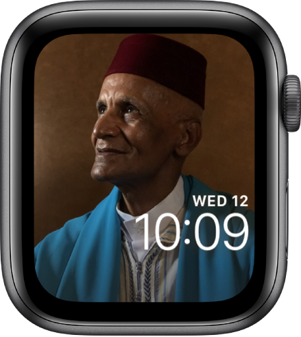 The Photos watch face shows a photo from your synced photo album. The face shows the date above the time.