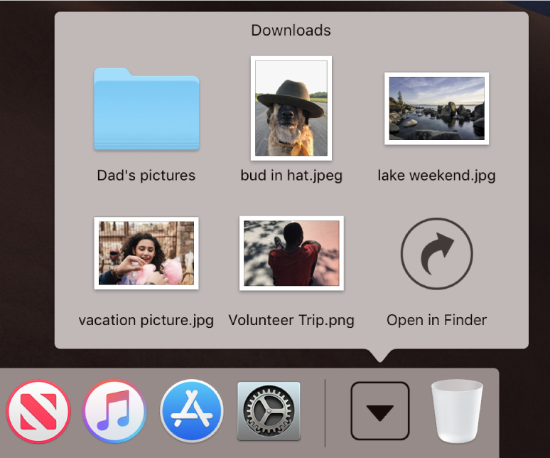 The Downloads stack in the Dock opened to show its contents in a grid.