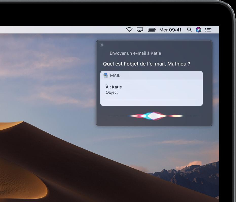 La fenêtre Siri dans le coin supérieur droit de l'écran, montrant un e-mail en train d'être dicté.