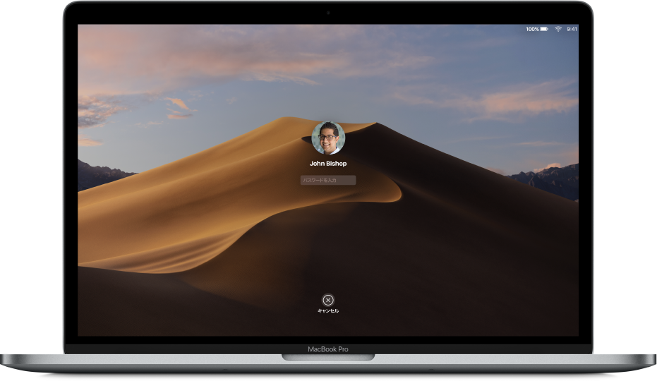 Mac のデスクトップ。ロックされたログイン画面が表示されていて、中央にパスワードのフィールド、下部に「キャンセル」ボタンがあります。