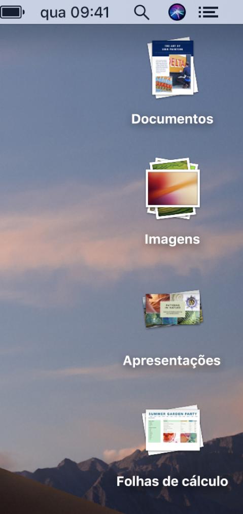 A secretária de um Mac com quatro pilhas — para documentos, imagens, apresentações e folhas de cálculo — ao longo da extremidade direita do ecrã.