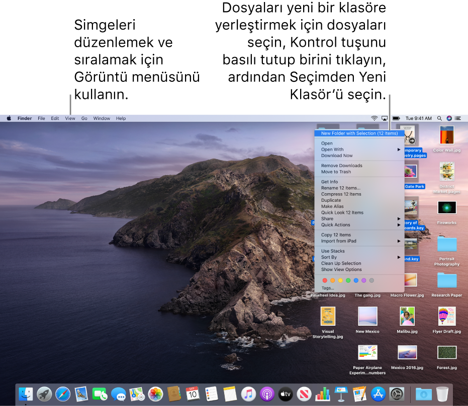 Dosyaların olduğu bir masaüstü örneği. Simgeleri gruplamak ve sıralamak için ekranın sol üst kısmındaki Görüntü menüsünü kullanın. Masaüstündeki dosyaları düzenleyebilirsiniz; yeni bir klasöre yerleştirmek için dosyaları seçin, Kontrol tuşuyla birini tıklayın, sonra Seçimle Yeni Klasör'ü seçin.