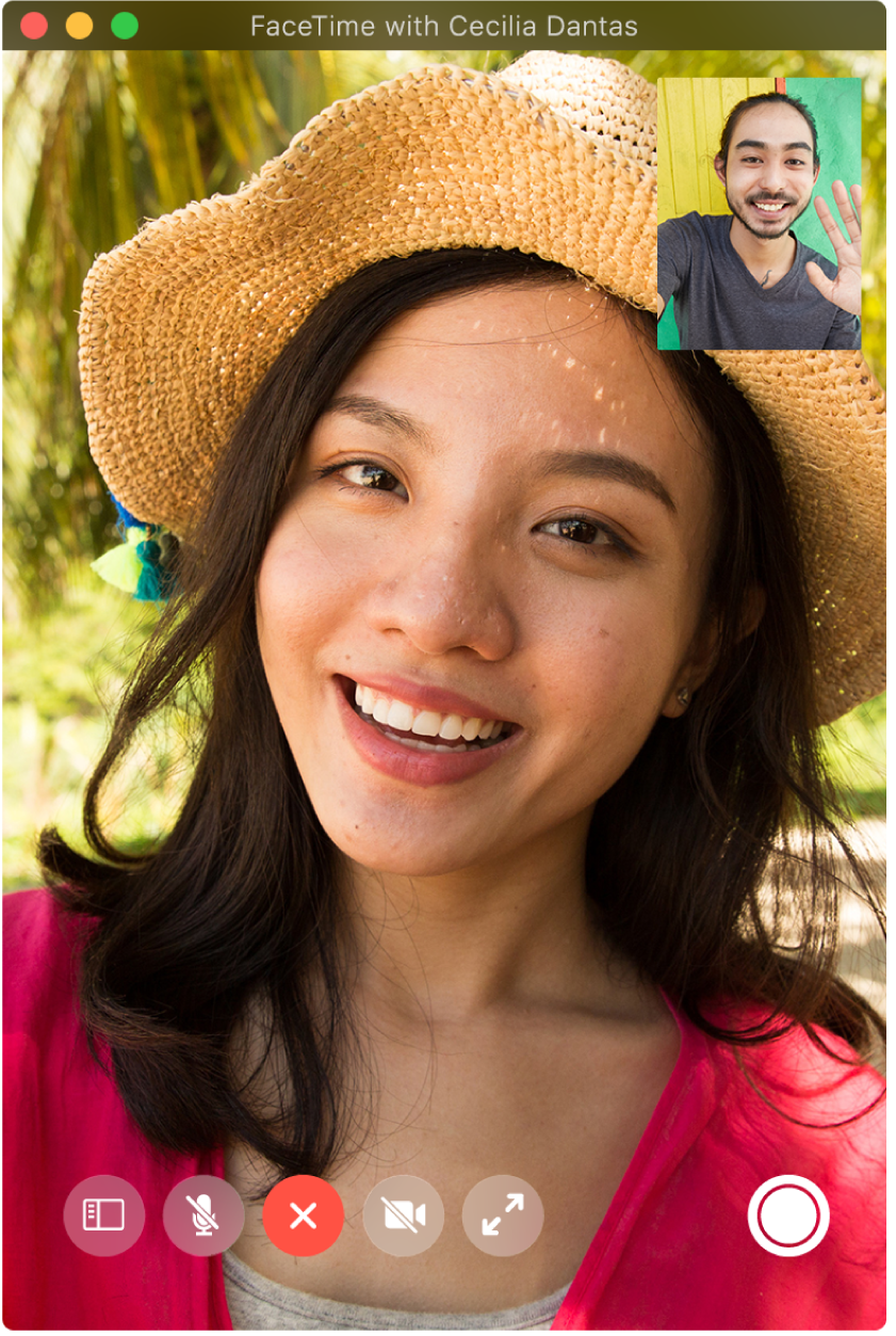 The FaceTime window showing two people on a call; the person who made the call is in the picture-in-picture window in the upper-right corner. In the bottom-right corner is the Live Photo button, which either caller can click to capture a Live Photo of the moment.