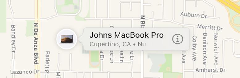 En närmare titt på infosymbolen för Johns MacBook Pro.