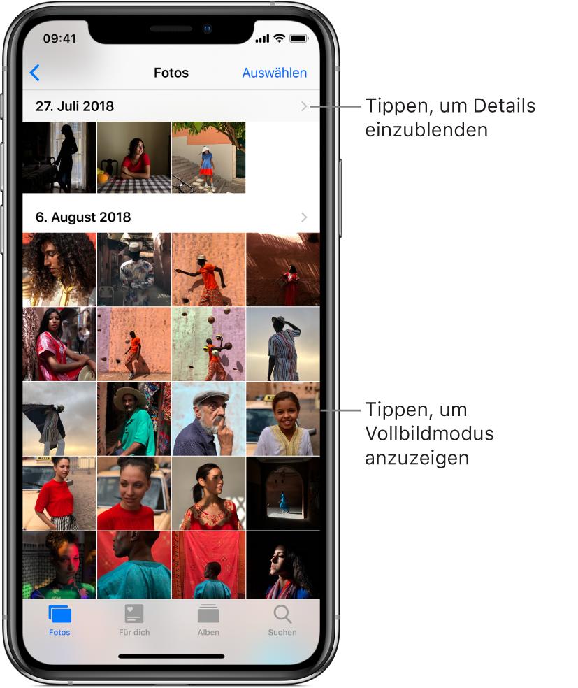 """Die App """"Fotos""""; am unteren Bildschirmrand sind von links nach rechts die Tabs """"Fotos"""", """"Für dich"""", """"Alben"""" und """"Suchen"""" zu sehen. Aktuell ist der Tab """"Fotos"""" ausgewählt. Oben auf dem Bildschirm sind in einem Raster die Miniaturen der nach Momenten gruppierten Fotos zu sehen. Über jedem Moment wird das Datum eingeblendet, an dem die enthaltenen Fotos entstanden. Beim Tippen auf das Datum werden die Details zum betreffenden Moment eingeblendet. Beim Tippen auf eine Miniatur wird das betreffende Foto in voller Bildschirmgröße angezeigt."""