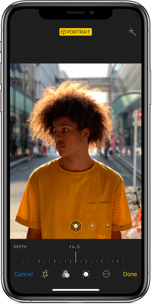 The Edit screen of a Portrait mode photo. The photo is in the center of the screen and below the photo is a slider to adjust the Depth Control. Below the slider from left to right are the Cancel, Crop, Filters, Timer, More, and Done buttons.