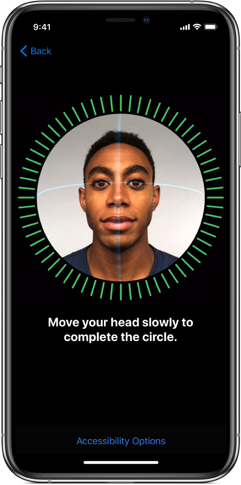 The Face ID recognition setup screen. A face is showing on the screen, enclosed in a circle. Text below that instructs you to move your head slowly to complete the circle.