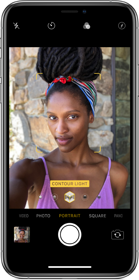 The Camera screen with Portrait mode selected. In the viewer, a box shows that the Portrait Lighting option is set to Contour Light, and there's a slider to change the lighting.