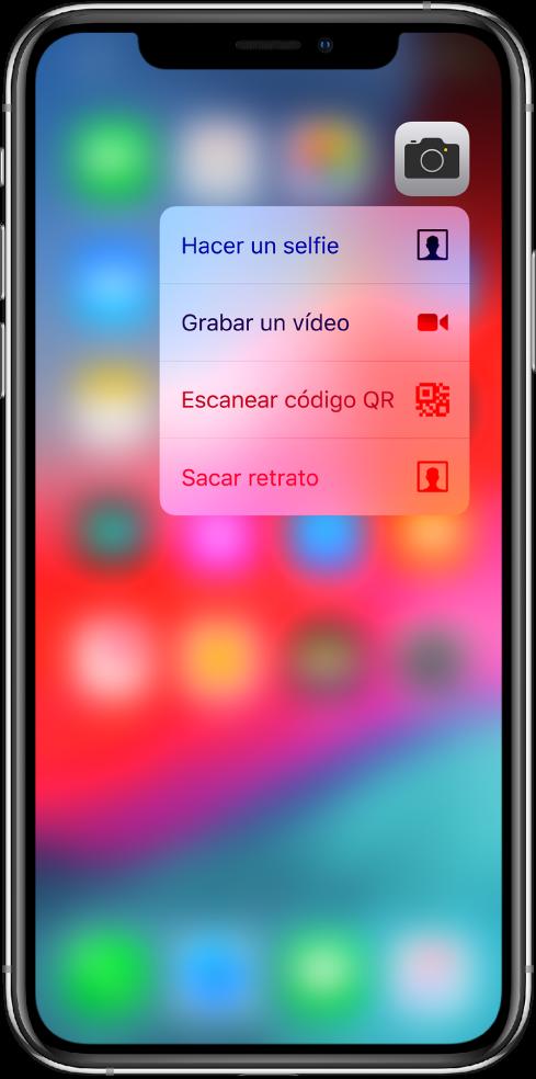 Pantalla de inicio borrosa con el menú de acciones rápidas de la aplicación Cámara debajo del icono de la aplicación.