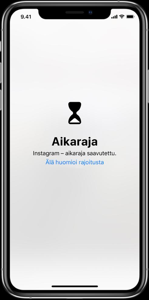 Näytöllä näkyy Aikaraja-ilmoitus, joka kertoo, että tänään Instagramissa on vietetty tunti aikaa. Ilmoituksen alla on Älä huomioi rajoitusta -painike.