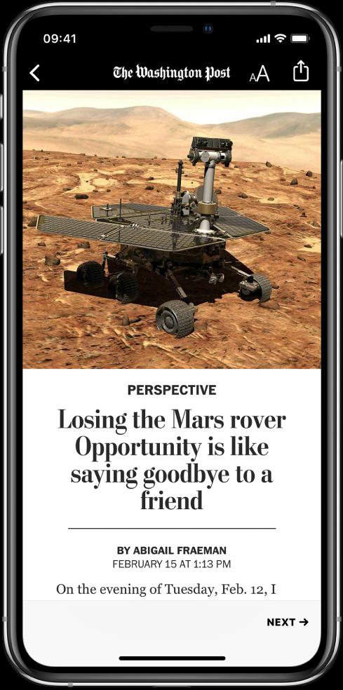 En haut de l'écran se trouvent un bouton Back, le nom de la publication, le bouton Text Size et le bouton Share. En dessous se trouve une image liée à l'article, suivie par le titre de ce dernier et une partie de sa première ligne de texte.