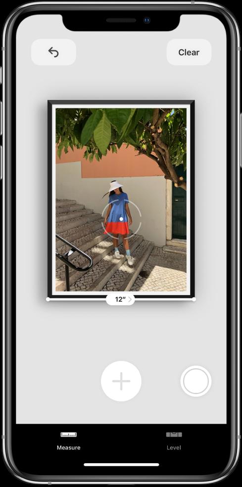 """Matuojama įrėminta nuotrauka, apatiniame krašte nurodytas jos plotis. Mygtukas """"Take Picture"""" yra viršutiniame dešiniajame kampe."""