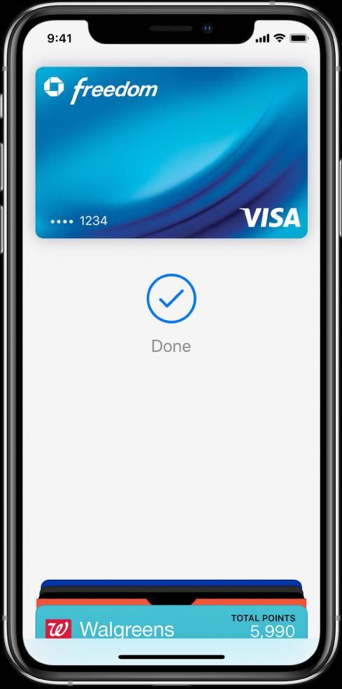 """Kredītkarte ekrānā Wallet. Zem kartes ir kontrolatzīme un vārds """"Done""""."""