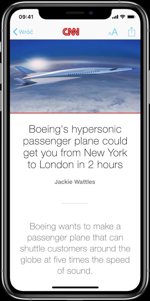 Ekran aplikacji News zpublikacją biznesową otwartą zaplikacji Giełda. Na górze ekranu wyświetlane są (od lewej do prawej) przyciski: powrotu, wyglądu iudostępniania.
