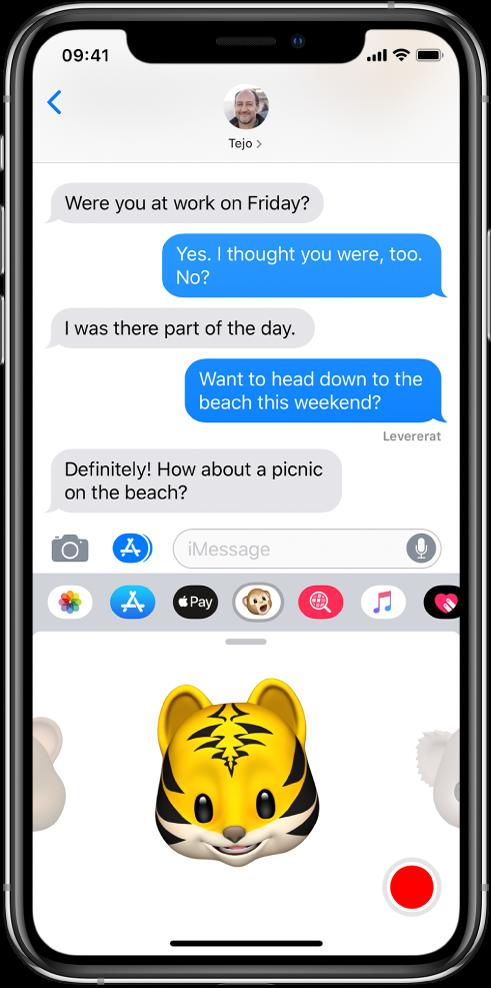 En konversation i Meddelanden med en Animoji markerad och klar att spelas in innan den skickas.