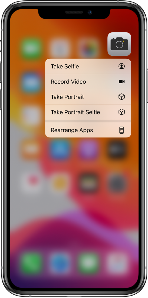The Home screen blurred, with the Camera quick actions menu showing below the Camera icon.