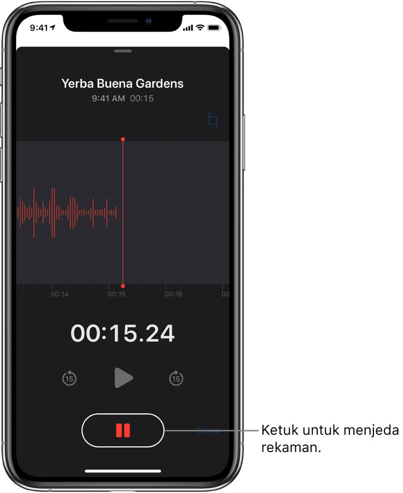 Layar Memo Suara menampilkan perekaman sedang berlangsung, dengan tombol Jeda yang aktif dan kontrol pemutaran yang diredupkan untuk memutar, melewati maju 15 detik, dan melewati mundur 15 detik. Bagian utama layar menampilkan bentuk gelombang rekaman yang sedang dibuat dengan indikator waktu.
