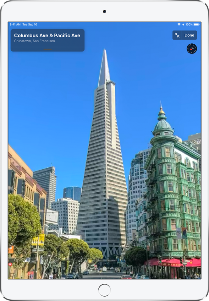 A full-screen view of a street leading to the Transamerica Pyramid building