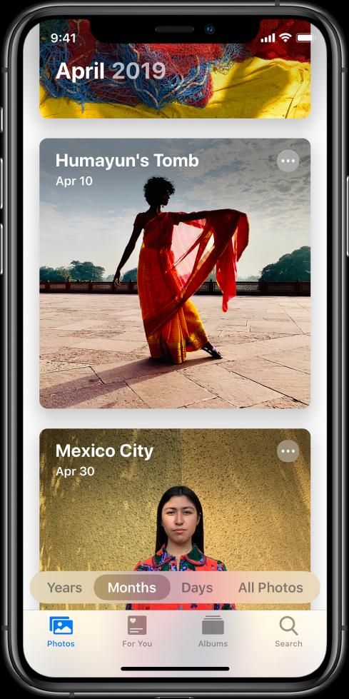 Екран в приложението Photos (Снимки). Избрани са етикет Photos (Снимки) и преглед Months (Месец). Показани са две събития от месец април 2019—Humayan's Tomb и Mexico City.