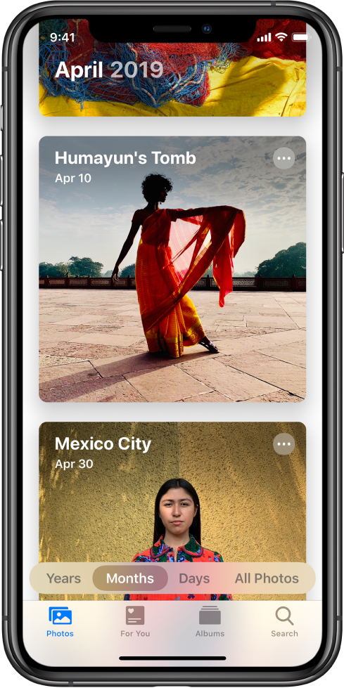 En skærm i appen Fotos. Fanen Fotos og månedsoversigten er valgt. Der vises to begivenheder fra april 2019, Humayun's Tomb og Mexico City.