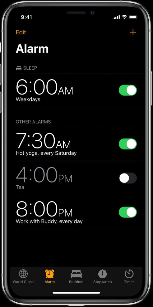 Tab Alarm, menampilkan empat alarm yang diatur untuk berbagai waktu.