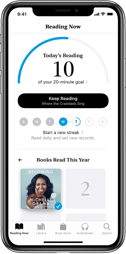 """A secção """"Metas de leitura"""" em """"A ler"""". O contador de leitura mostra que foram concluídos 10 minutos de uma meta de leitura de 20 minutos. Por baixo do contador está um botão para continuar a ler e círculos que mostram os dias da semana, de domingo a sábado; os contornos azuis à volta do círculo indicam o progresso de leitura nesse dia. Na parte inferior da página estão as capas dos livros lidos este ano."""