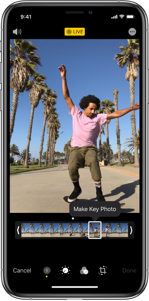 """实况照片屏幕,中间是实况照片。""""实况""""按钮位于顶部中间,""""声音""""按钮位于左上方。实况照片下方是画格检视器,其中""""设为主要照片""""按钮处于活跃状态。画格检视器的任一端有两个条,允许您修剪实况照片。"""