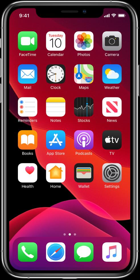 """打开了""""深色""""模式的 iPhone 主屏幕。"""