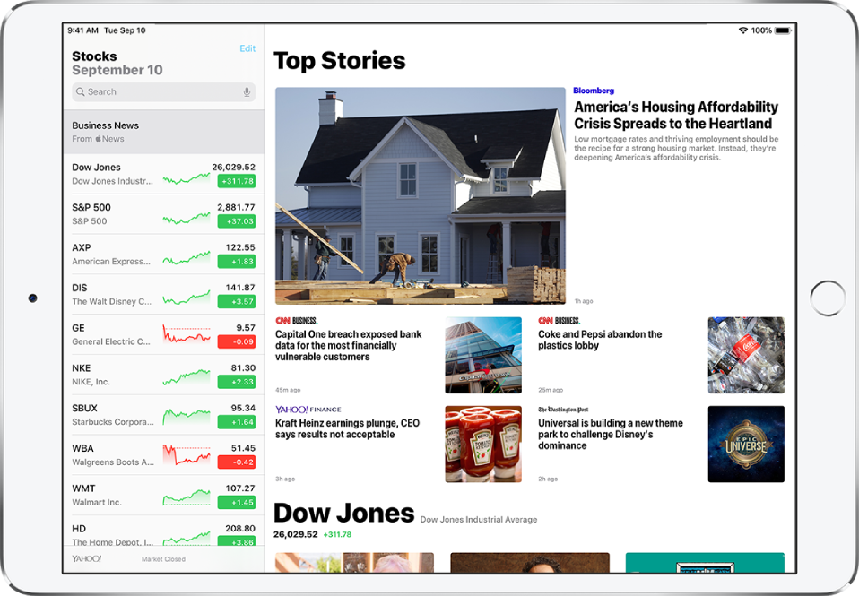 The Stocks screen in landscape orientation. The search field is in the top-left corner. Below the search field is the watchlist. Top Stories related to stocks in the watchlist fill the rest of the screen.