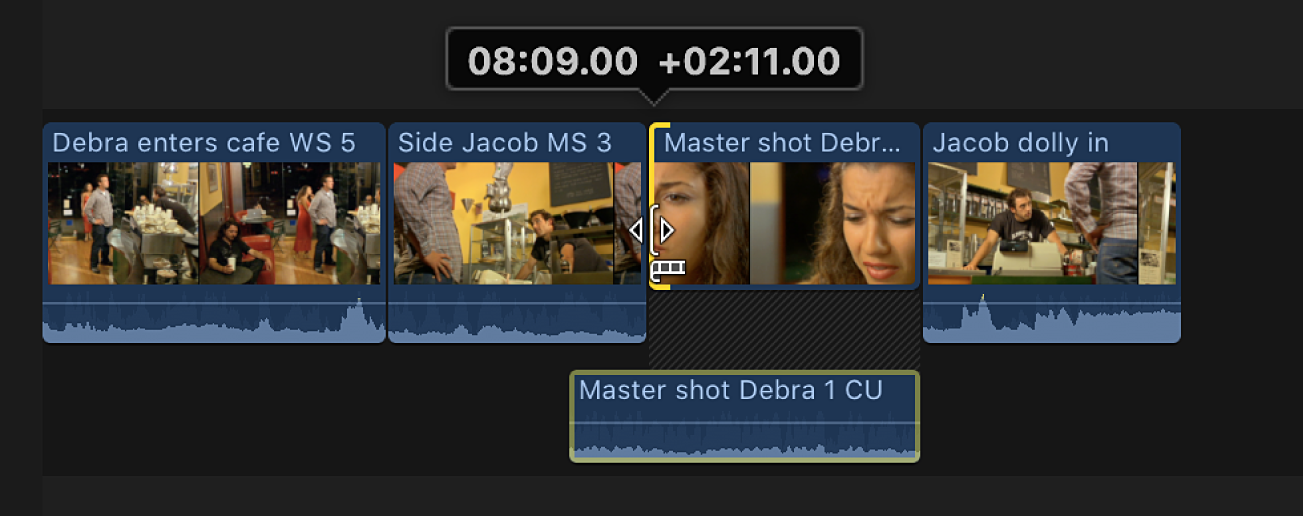 The video start point being moved right, causing the audio portion of the clip to overlap the audio from the preceding clip