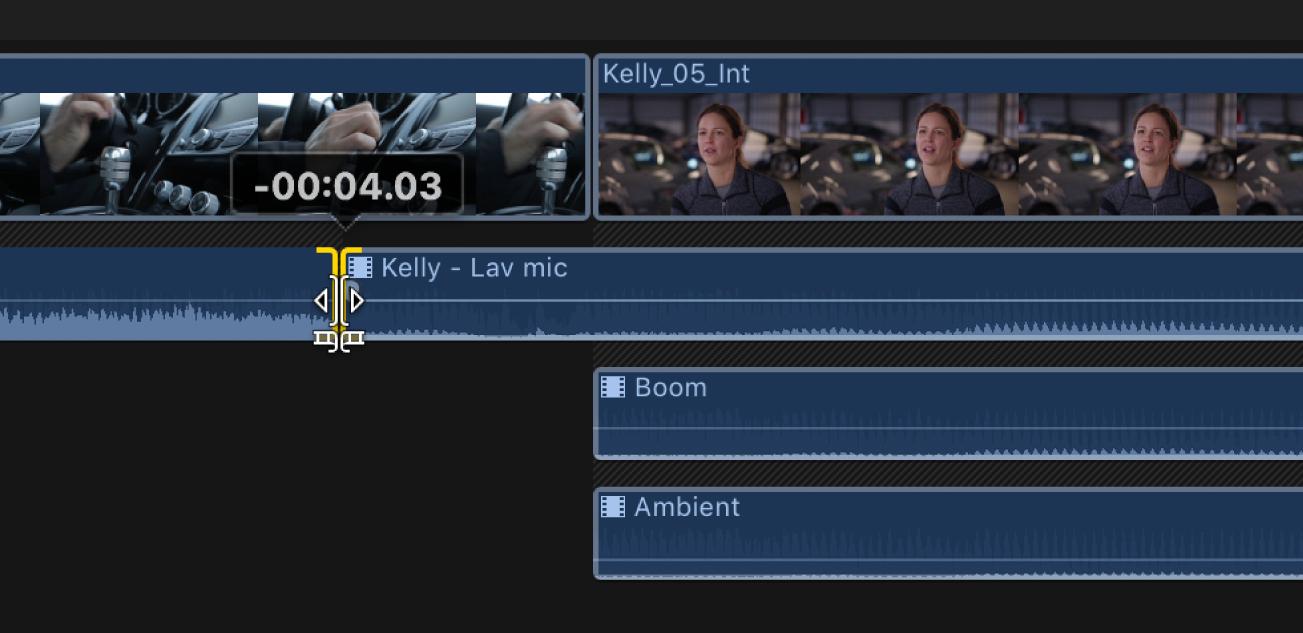 Línea de tiempo con el punto de edición entre los componentes de audio contiguos mientras se arrastra hacia la izquierda