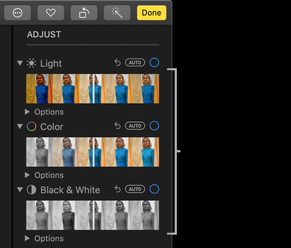 De schuifknoppen voor 'Licht', 'Kleur' en 'Zwart-wit' in het paneel 'Pas aan'. Boven elke schuifknop wordt de knop 'Automatisch' weergegeven.
