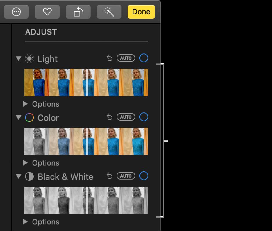 Повзунки «Світлі», «Колір» і «Чорно-білий» на панелі «Коригувати». Кнопка «Автоматично» відображається під кожним повзунком.